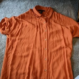 Pumpkin colored tunic length button down shirt